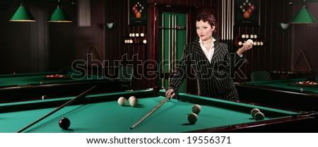 Beautiful woman near the billiard-table - stock photo