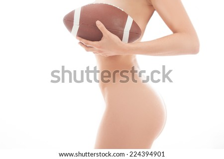 Beautiful woman nude holding a football isolated over white background - stock photo