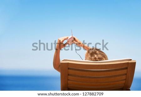 beautiful woman on a beach chair - stock photo