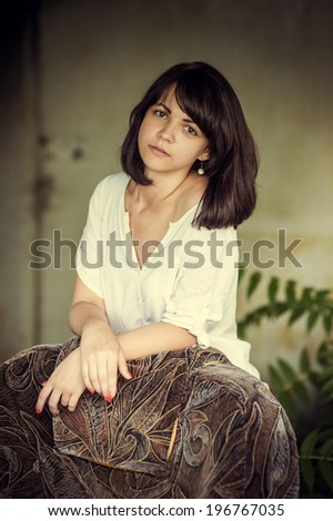 Beautiful woman on a city street. Outdoor portrait of attractive teen girl, warm toned. Outdoor color fashion sensual portrait of young beautiful woman