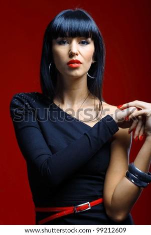 Beautiful woman on a dark red - stock photo