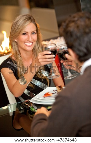 Beautiful woman on a date at a fancy restaurant - stock photo
