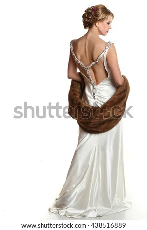 beautiful woman on a white background .vivid emotions.cape with fur - stock photo