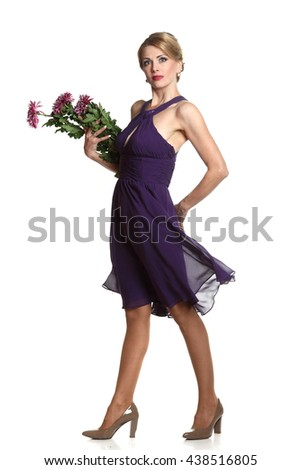 beautiful woman on a white background .vivid emotions. with a bouquet of flowers - stock photo