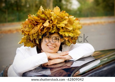 Beautiful woman on autumn garland