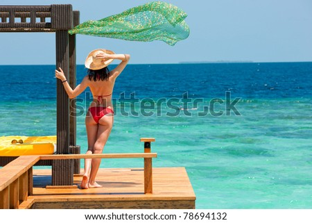 beautiful woman on background of ocean - stock photo