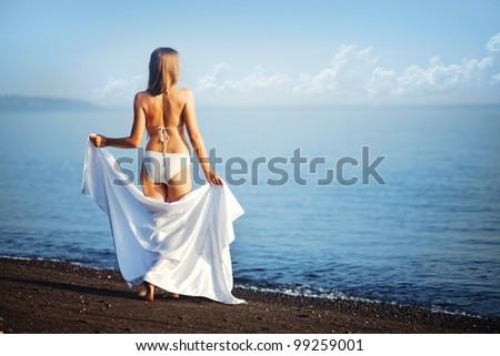 Beautiful woman on beach, bali - stock photo
