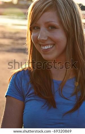 Beautiful woman on Beach, with sunset taken closeup - stock photo