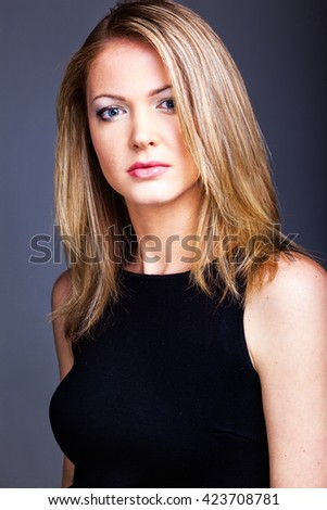 Beautiful woman on black classical dress pose in studio
