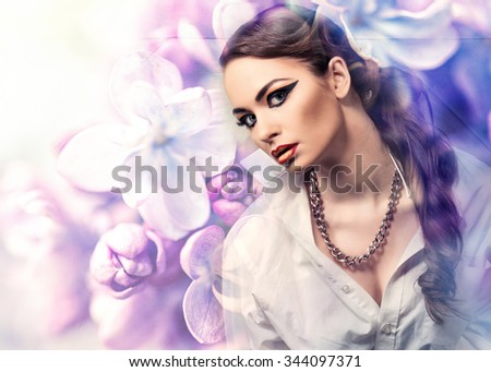Beautiful  woman on blooming lilac flowers background - stock photo