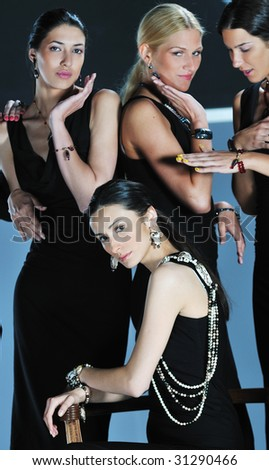 beautiful woman on fashion show piste with gold jawel - stock photo