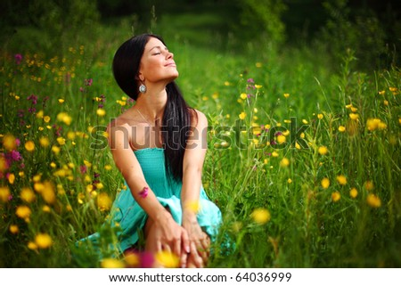 beautiful woman on flower field - stock photo