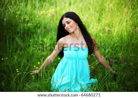 beautiful woman on flower field - stock photo