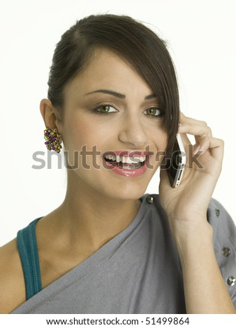 Beautiful woman on phone with a very confident, freindly smile. - stock photo