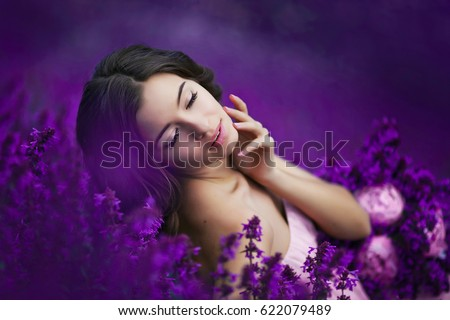beautiful woman on purple background. woman with purple flowers