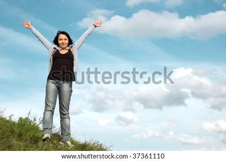 Beautiful woman on sky background.