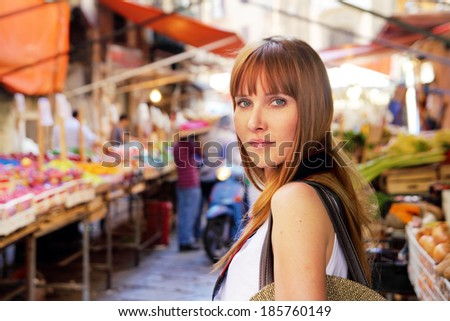 beautiful woman on street market - stock photo