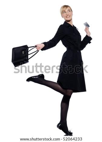 beautiful woman on studio white background hoding a credit car - stock photo