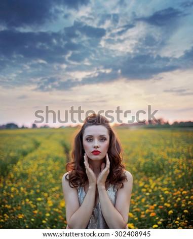 Beautiful woman on summer flower meadow - stock photo