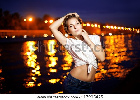 Beautiful woman on the background of night city lights