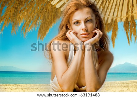 beautiful woman on the background of the beach - stock photo