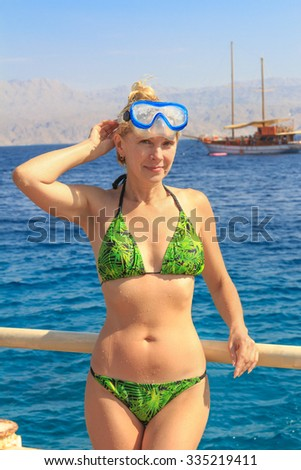 Beautiful woman on the background of the Red Sea