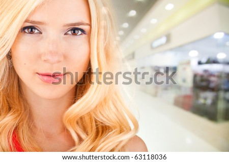 beautiful woman on the background of the shop interior - stock photo