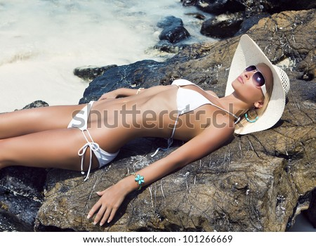 Beautiful woman on the beach. - stock photo
