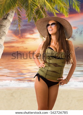Beautiful woman on the beach at sunset - stock photo