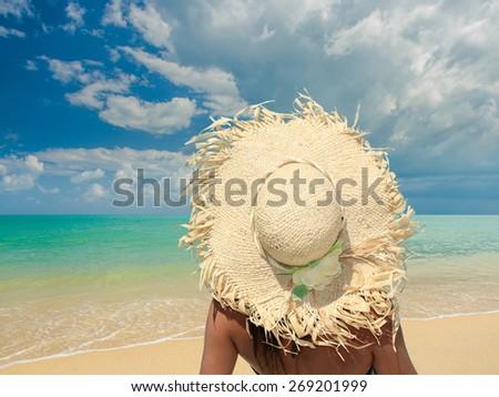 Beautiful woman on the beach in Bali Indonesia - stock photo
