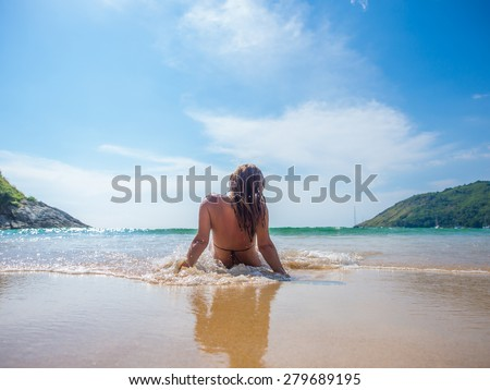 Beautiful woman on the beach in Phuket Thailand. - stock photo