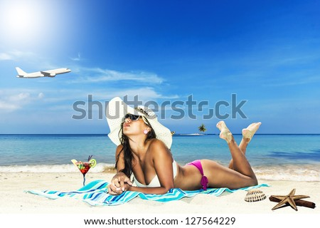 Beautiful woman on the beach - Travel concept - stock photo