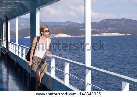 beautiful woman on the deck of the ferry