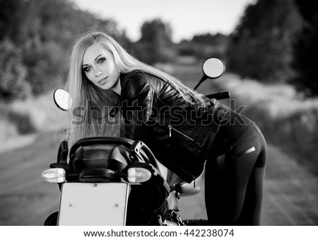 Beautiful woman on the motorcycle black and white