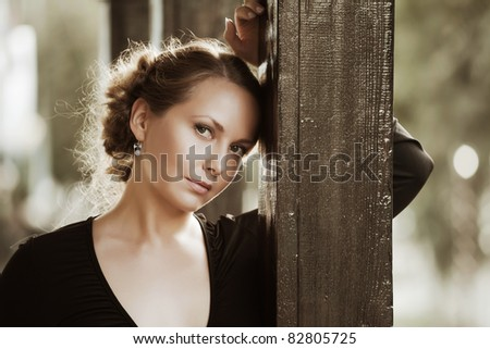 Beautiful woman on the porch - stock photo