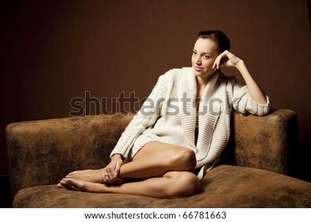 beautiful woman on the sofa - stock photo