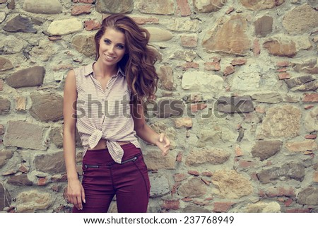 Beautiful woman on the terrace of an Italian country house  - stock photo