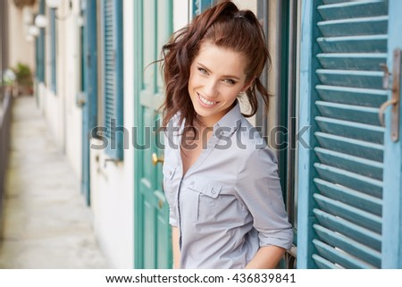 Beautiful woman on the terrace of an Italian  house