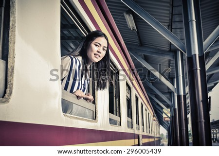 Beautiful Woman on the train.Traveling concept.Travel by Train.Young woman traveling by train - stock photo