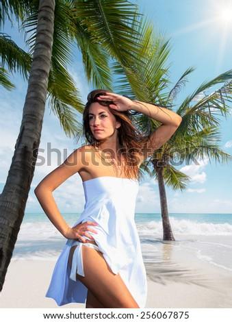 Beautiful woman on the tropical beach - stock photo