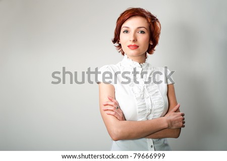 beautiful woman on white background stares at you - stock photo