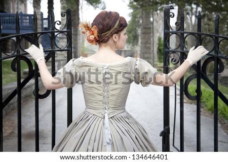Beautiful woman opening Gate - stock photo