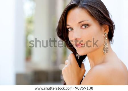 beautiful woman outdoor portrait combing her hair - stock photo