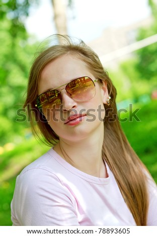 Beautiful woman outdoors in glasses - stock photo