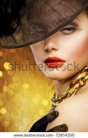 Beautiful Woman over luxury gold background - stock photo