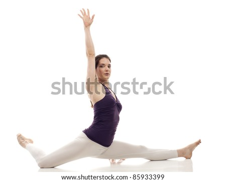 Beautiful woman performing a split isolated on white - stock photo