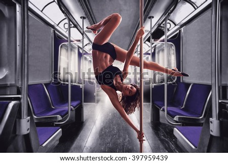 Beautiful woman performing pole dance.Collage in train  background. - stock photo
