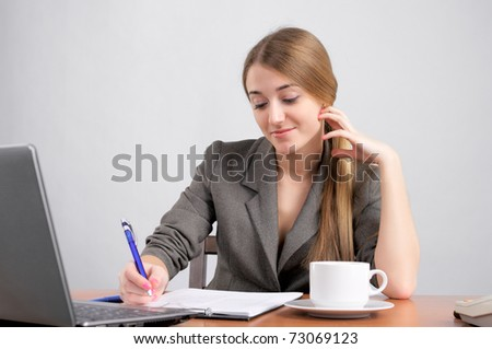 Beautiful woman planning work in the office - stock photo