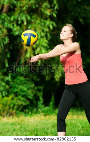 beautiful woman playing volleyball at the park - stock photo
