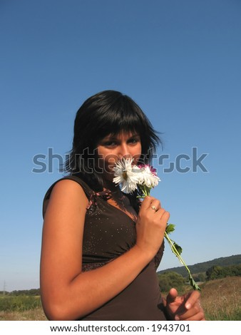 Beautiful woman playing with flower